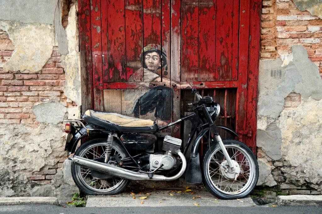 Boy on Motorcycle Streetart